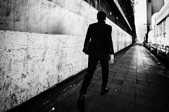 A man in a hurry (tomorca) Tags: man walk step wall blackandwhite monochrome fujifilm xt2