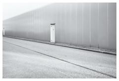 Doors in perspective (leo.roos) Tags: door wall deur muur industrieterrein perspective road weg industrialpark industrialestate tradingestate abcwestland noiretblanc a7 meyertrioplan2850 1942 projectorlens trioplan5028 projectionlens darosa leoroos