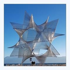 stars and stripes (overthemoon) Tags: switzerland suisse schweiz svizzera romandie vaud lausanne ouchy cold icy blue windy thursdaywalk angelduarte ouvertureaumonde sculpture metal mountains lake léman