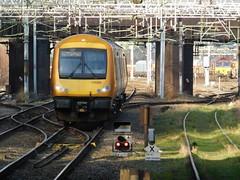 Passage beneath the wires (The Walsall Spotter) Tags: westmidlandsrailway newtonjunction bescot tamebridgeparkwaystation class170turbostar 170509 overheadlineequipment overheadwires