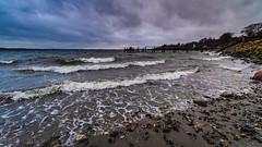 Scheißwetter vom feinsten... (Davedesignz7993) Tags: wellen strand wind wolken steine steg förde deutschland dänemark fui fujixt10 walimex japan korea