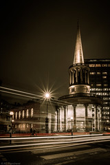 As all souls pass by (Through_Urizen) Tags: allsouls architecture art category england external lighttrails london nightscenes places street canon canon1585mm canon70d outdoor streetphotography regentstreet church churchspire lightsatnight lightstar afterdark night traffic road crossing buildings capitalcity city cityscape