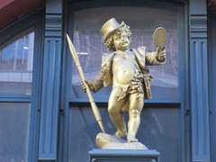 Puck Building Cherub Two - What Fools These Mortals Be 1841 (Brechtbug) Tags: 2nd gold statue baby puck character over entrance with top hat holding mirror from old humor cartoon magazine the building lafayette street new york city 02162019 nyc 2019 east houston st downtown manhattan william shakespeare putti cherub cherubim art architecture buildings cupid like valentines day holiday