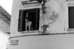 view from the window (Giorgos Voulgaris) Tags: nikonem film 35mm 400 agfa bw blackwhite monochrome candid street streetphotography girl window view corfu daytime analog apx