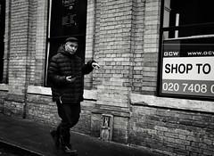 Hand Gestures (Bury Gardener) Tags: monochrome mono burystedmunds bw blackandwhite britain suffolk streetphotography street streetcandids snaps strangers candid candids people peoplewatching folks nikond7200 nikon england eastanglia uk 2019 cornhill