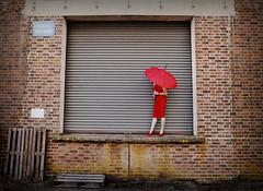 The Urbanist... (Harleynik Rides Again.) Tags: reddress parasol loadingbay baywatch woman womaninurbanexploration urbex facelessportrait juxtaposition harleynikridesagain