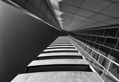 Lookup (Leipzig_trifft_Wien) Tags: berlin deutschland de lookingup tower skyscraper building monochrome facade balcony glass concrete modern black white bnw city urban sky blackandwhite bw bnwsoul bnwmood light shadow