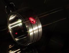Always The Sun (Silke Klimesch) Tags: macromonday hmm timepieces sonnenuhr spiegelung spektralfarben nomos nomosglashütte sundial pocketsundial lowkey starfilter laser red spectralcolours bling reflection zonnewijser solur cadransolaire cadransolar ceassolar meridiana orologiosolare aurinkokello relógiodesol relojdesol zegarsłoneczny güneşsaati ηλιακόρολόι 日時計 해시계 солнечныечасы cloggréine นาฬิกาแดด 日晷 macro ring focusstacking timeisrelative alberteinstein alwaysthesun thestranglers thesunaintgonnashineanymore thewalkerbrothers 1966 1986 makrofotografie makro olympus omd em5markii mzuikodigitaled60mm128macro luminar3 on1photoraw2019 microfourthirds