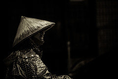 In the dark.- a question (hkokko) Tags: halongbay market streetphotography vietnam black blackwhite customer dark discussion dots expression female hat intense lady lowkey streetportrait teeth travel
