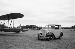 Ricoh 500RF - Agfa APX 100 (25) (meniscuslens) Tags: vintage car camera film ricoh 500rf agfa apx shuttleworth bedfordshire grass aircraft biplane bw bnw mono monochrome