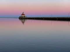 A Slight Tinge of Spring at Sunset (rbodgers) Tags: reflection gradient lake winter spring sunset water canal duluth lakesuperior lighthouse shotoniphone