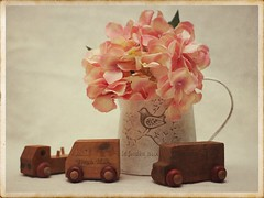 Still Life (N.the.Kudzu) Tags: tabletop stilllife vase tin pitcher flowers wooden cars canoneosm 7artisans35mmf12 photoscape texture frame home