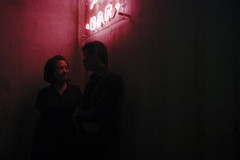 Romance (OzGFK) Tags: luckybar singapore asia cinestill800t cinestill cinestillfilm night bar redneon red couple romance love hollandvillage nightlife nikon nikkor portrait