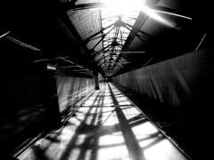 Nordelec Skylight Cooridor (MassiveKontent) Tags: skylight bwphotography streetshot architecture geometric lines pointsaintcharles montreal bw contrast city monochrome urban blackandwhite street photo montréal quebec canada photography concrete shadows noiretblanc blancoynegro metal symmetry noir silhouette
