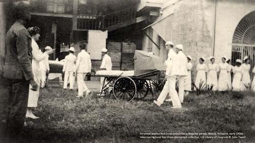 Personnel pushed Red Cross ambulance in Magellan parade, Manila, Philippine, early 1900s