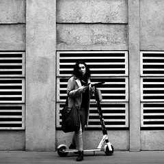 Against the lined square (pascalcolin1) Tags: paris13 femme woman trottinette scooter mur wall lined rayé regard look photoderue streetview urbanarte noiretblanc blackandwhite photopascalcolin 50mm canon50mm canon