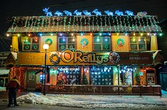 Christmas on George Street (Karen_Chappell) Tags: stjohns newfoundland nfld georgestreet night lights xmas noel holiday architecture bar pub canada atlanticcanada avalonpeninsula eastcoast christmas snow winter december building decor decorations colourful colours multicoloured colour color downtown city urban canonef24105mmf4lisusm