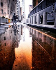 The rain finally broke... (LAKAN346) Tags: street downtown reflections color tones streetstyle puddle manhattan repetition saturation northeast myview contrast pov nyc newyorkcity rain snow morning light