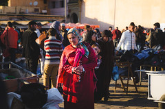 Meknes' People (Ash and Debris) Tags: africa square urbanlife market crowd morocco street people look red streetlife urban child citylife woman meknes ctiy life cloth mother women