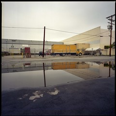 Tilt (ADMurr) Tags: la eastside industrial warehouse overcast poles lines yellow puddle reflection hasselblad 500cm 50mm distagon fuji 400 dba301