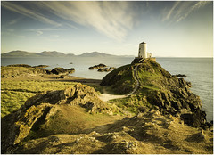 Twr Mawr Lighthouse, Anglesey (Charles Connor) Tags: twrmawrlighthouse anglesey northwales lighthouses eveninglight landscapephotography landscape sidelight dramaticskies colourfulskies texture rocks seascapes canondslr leadinglines clouds