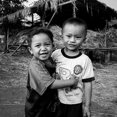 Kids, Paksong, Laos (pas le matin) Tags: kids children enfants asia asie laos lao southeastasia people boy portrait street candid nb bw noiretblanc blackandwhtie monochrome canon 7d canon7d canoneos7d eos7d