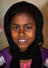 Portrait of a smiling Beja tribe girl, Red Sea State, Port Sudan, Sudan (Eric Lafforgue) Tags: africa baja beja beniamer colorimage cushitic day girls headshot indoors lookingatcamera northafrica northsudan northernsudan oneperson oneteenagegirlonly photography portsudan portrait realpeople redseastate smile smiling sudan sudan181203 teenagers traveldestinations tribal tribe vertical sd