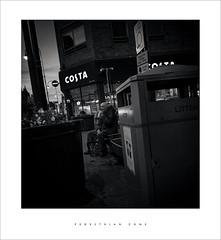 Pedestrian zone (Parallax Corporation) Tags: streetlife man blackwhite candid monochrome southport eastbankstreet costacoffee litter sonygmaster24mmf14 sonya7rii