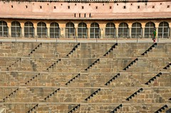 Stepped Across (Pedestrian Photographer) Tags: chand baori stepwell agra india steps water woman sunny afternoon