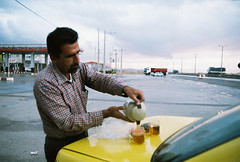 Hussein with his highway tea (Aspa Tz) Tags: iran yazd analogue film zenit superia 200 portrait human man atmosphere travel road