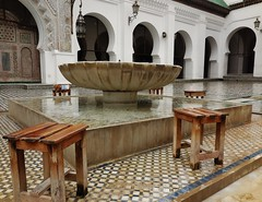 the ablution fountain (SM Tham) Tags: africa morocco fes medina fesalbali walledcity alqarawiyyinmosque alkaraouinemosque mosque madrasa university religiousschool building architecture arches courtyard marble fountain ablution washing cleansing stools wet water