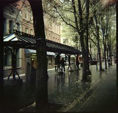 train stop (lawatt) Tags: train station sidewalk raining portland oregon film 120 portra 400nc diana f