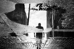 nowhere man (javan123) Tags: wet water reflection brick ground buildings monochrome rain