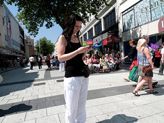 CHecking her phone (kevin Akerman) Tags: woman mobile phone street cardiff shops
