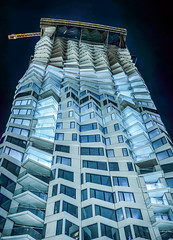 as the tower turns (pbo31) Tags: bayarea california nikon d810 color march 2019 boury pbo31 night dark sanfrancisco city urban construction folsomstreet architecture contemporary crane tower financialdistrictsouth rinconhill panorama large stitched panoramic blue