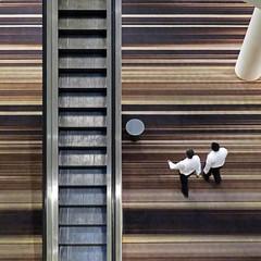 escalator bypass (Jim_ATL) Tags: escalator hotel lobby two men striped carpet atlanta aerial pov