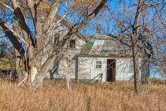 Abandoned House in Rural South Dakota (JacobBoomsma) Tags: dilapidated property spooky depreciated decrepit abandoned landscape southdakota old country weathered outdoors dwelling overcast rustic plains house home midwest yard south dakota town capa decay ghost rural prairie condemned dynamic fourche sunset grass black belle 1900s hills land high outside range hdr