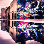 Puddle reflection and mural really does change the city. thumbnail