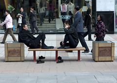 Tired Chinese Men Sit On A Bench, Beijing, China (Eric Lafforgue) Tags: mg4136 asia barefoot beijing bench china chinese colorpicture contrast exhausted fatigue fulllenght groupofpeople heat horizontal outdoor pekin realpeople rest resting shoe shoes shop shoppingstreet sit sitting sportshop street tired travel wangfujingstreet