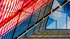Six Sided (DobingDesign) Tags: morelondonplace london londonarchitecture morelondon londonbridge architecture lines stripes glass cladding fosterpartners dimensions diagonals space texture sleek shiny reflections sunlight rays patterns geometric angular color colourpop lightandshadow triangles red blue redwhiteandblue lighting spots