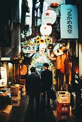 omoide yokocho. (barbs--) Tags: izakaya omoideyokocho analog film 35mm kodakportra400 leicam6 streetphotography voigtländernokton35mm salarymen japan izakayaalley