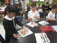 The students created clay fish using the additive method. They also created a base to hold the fish and are adding color to their sculpture using watercolors. (st.brigid2) Tags: