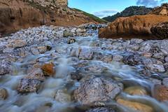 Rockaway Beach. Pacifica, CA. (j1985w) Tags: rocks river water longexposure pacifica california rockawaybeach sky clouds