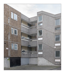 The Built Environment, South East London, England. (Joseph O'Malley64) Tags: thebuiltenvironment newtopography newtopographics manmadeenvironment manmadestructure building structure steelreinforcedconcretestructure reinforcedconcretestructure reinforcedconcrete concrete abandonedhousingestate housingestate estate abandoned derelict awaitingdemolition demolitionsite demolition housing homes dwellings abodes urban urbanlandscape architecture urbanarchitecture architecturalfeatures architecturalphotography documentaryphotography britishdocumentaryphotography southeastlondon london england uk britain british greatbritain texturedconcrete pebbledashing stairwell stairs steps balconies doubleglazedwindows upvcdoubleglazing upvc signs signage noballgames leadedwindow leadedglass flues wirereinforcedglass satellitedishes flatroof pavement tarmac wires wiring concretecancer rust oxidation ferrousmetals expansiononanatomicscale fujix fujix100t accuracyprecision