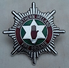 Northern Ireland Fire Brigade Cap Badge 1984-2006 (Lesopc) Tags: nifb northern ireland fire brigade service cap logo 1984 1985 1986 1987 1988 1989 1990 1991 1992 1993 1994 1995 1996 1997 1998 1999 2000 2001 2002 2003 2004 2005 2006 badge uk rescue