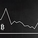 Business chart displaying Bitcoin market on blackboard
