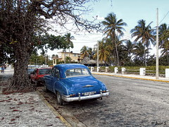 ... (Jean S..) Tags: car old ancient street trees cuba sky clouds city blue red