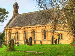 The Estate church at Howick Hall in Northumberland. (Digidoc2 - BACK!) Tags: church placeofworship architecture sky building religion old outdoors light estate estatechurch howickhall england graveyard graves lawn grass trees picturesque