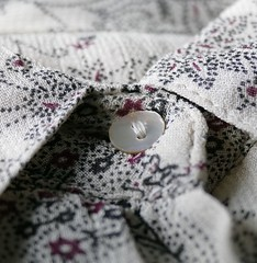 Buttoned up (tanith.watkins) Tags: cloth paisley fabric macromondays
