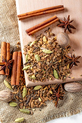 Tea with nutmeg, cloves, cinnamon sticks, star anise on a wooden Board (wuestenigel) Tags: alternative natural anise burlap nature medicine brown background tea timber drink effect macro healing backdrop blood organic wood cloves full closeup nutmeg healthy texture herbal tree system anti antioxidant dry health raw fresh spices forest wooden